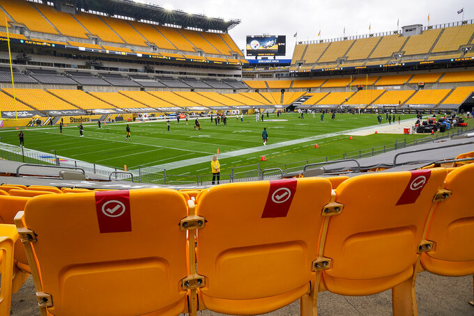 Seats are marked at Heinz Field to socially distance the approximately 5000 football fans that will be attending the NFL football game between the Pittsburgh Steelers and the Philadelphia Eagles in Pittsburgh, Sunday, Oct. 11, 2020. It will be the first Steelers home game that fans have been allowed to attend. (AP Photo/Gene J. Puskar)