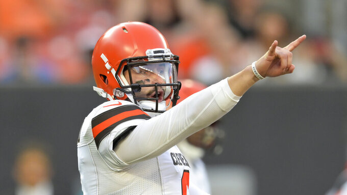 Cleveland Browns quarterback Baker Mayfield gives a signal during the first half of the team's NFL preseason football game against the Washington Redskins, Thursday, Aug. 8, 2019, in Cleveland. (AP Photo/David Richard)