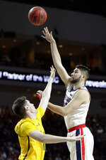 Gonzaga's Killian Tillie, right, shoots as San Francisco's Remu Raitanen defends during the first half of an NCAA college basketball game in the West Coast Conference men's tournament Monday, March 9, 2020, in Las Vegas. (AP Photo/Isaac Brekken)
