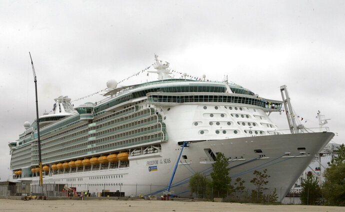 FILE - This May 11, 2006 file photo shows the Freedom of the Seas cruise ship docked in Bayonne, N.J. An attorney for an Indiana family whose 18-month-old daughter fell to her death in July from the cruise ship docked in Puerto Rico says the negligent homicide charges her grandfather now faces