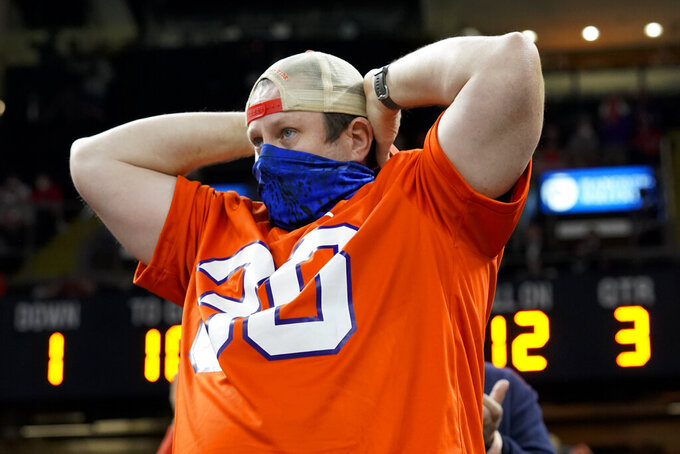 A Clemson fan watches during the second half of the Sugar Bowl NCAA college football game against Ohio State Friday, Jan. 1, 2021, in New Orleans. (AP Photo/Gerald Herbert)