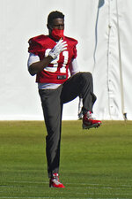 Tampa Bay Buccaneers wide receiver Antonio Brown (81) stretches during an NFL football practice Wednesday, Jan. 6, 2021, in Tampa, Fla. The Buccaneers play the Washington Football Team in a playoff game Saturday night. (AP Photo/Chris O'Meara)