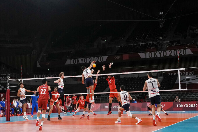 United States' Taylor Sander spikes the ball during the men's volleyball preliminary round pool B match between United States and Russian Olympic Committee at the 2020 Summer Olympics, Monday, July 26, 2021, in Tokyo, Japan. (AP Photo/Manu Fernandez)