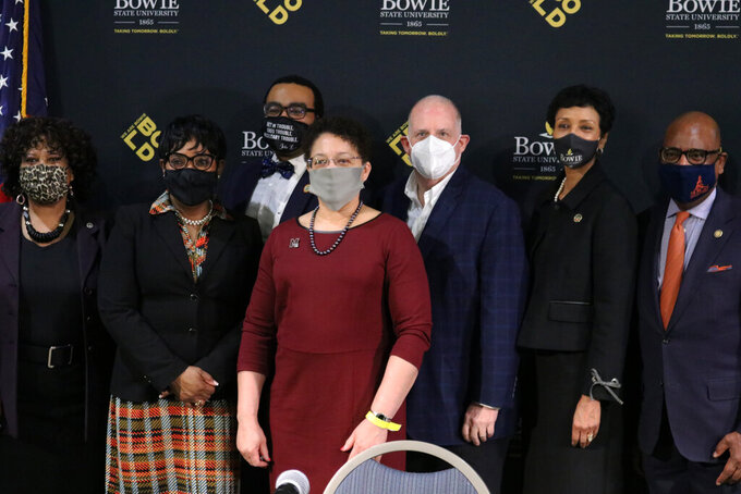 Gov. Larry Hogan, third from right, stands with lawmakers and presidents of Maryland's historically Black colleges and Universities after signing a bill on Wednesday, March 24, 2021 in Bowie, Md., to allocate $577 million over a decade to settle a federal lawsuit over underfunding at the state's four HBCUs. Standing from right to left: David Wilson, president of Morgan State University, Aminta Breaux, president of Bowie State University, Hogan, Heidi Anderson, president of the University of Maryland Eastern Shore, Sen. Charles Sydnor, Maryland House Speaker Adrienne Jones and Sen. Melony Griffith.  (AP Photo/Brian Witte)
