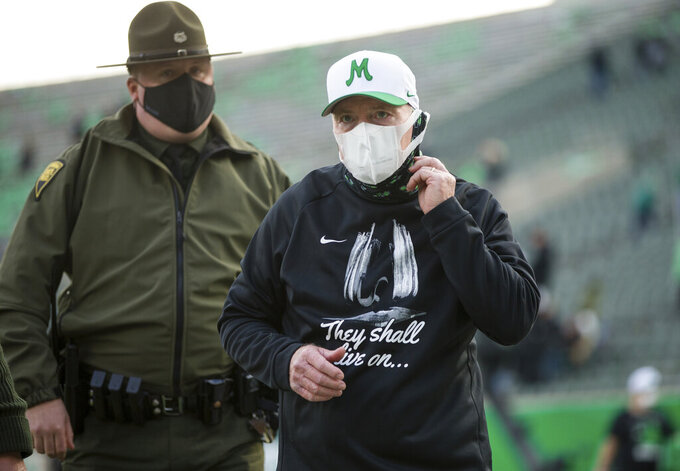 Marshall coach Doc Holliday leaves the field after the team'swin against Middle Tennessee in an NCAA college football game Saturday, Nov. 14, 2020, in Huntington, W.Va. (Sholten Singer/The Herald-Dispatch via AP)