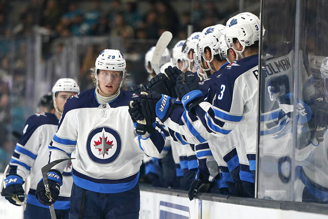 Winnipeg Jets right wing Patrik Laine (29) is congratulated by teammates after scoring a goal against the San Jose Sharks during the first period of an NHL hockey game in San Jose, Calif., Wednesday, Nov. 27, 2019. (AP Photo/Tony Avelar)