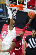 Rutgers' Myles Johnson (15) blocks the shot of Indiana's Al Durham (1) during the second half of an NCAA college basketball game at the Big Ten Conference tournament, Thursday, March 11, 2021, in Indianapolis. Rutgers won 61-50. (AP Photo/Darron Cummings)