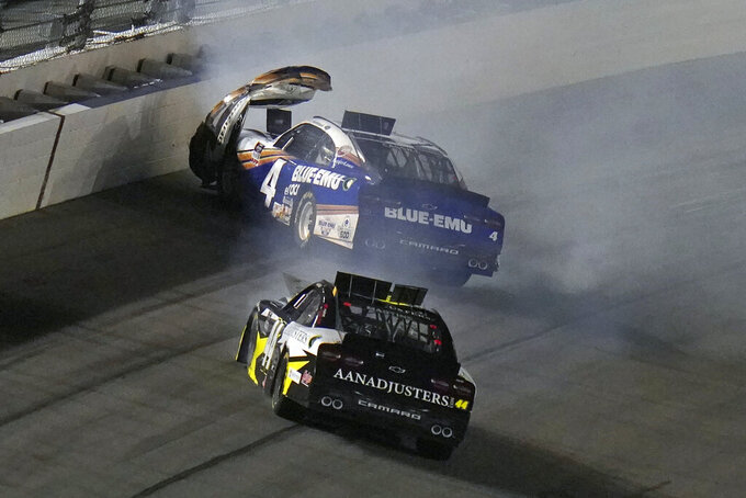 Landon Cassill (4) and Tommy Joe Martins (44) crash during a NASCAR Xfinity Series auto race Saturday, Feb. 13, 2021, at the Daytona International Speedway in Daytona Beach, Fla. (AP Photo/Chris O'Meara)