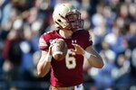 Boston College quarterback Dennis Grosel looks to pass during the first half of an NCAA college football game against North Carolina State in Boston, Saturday, Oct. 19, 2019. (AP Photo/Michael Dwyer)