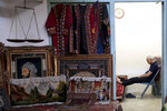 A carpet seller sits at his shop in the old main bazaar in Tehran, Iran, Sunday, June 23, 2019. As the U.S. piles sanction after sanction on Iran, it's the average person who feels it the most. As the U.S. piles sanction after sanction on Iran, it's the average person who feels it the most. At the time of the nuclear deal, Iran's currency traded at 32,000 rials to $1. Today, it costs over 130,000 rials for one U.S. dollar. (AP Photo/Ebrahim Noroozi)