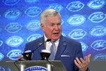 FILE - In this July 18, 2019, file photo, North Carolina head coach Mack Brown speaks during the Atlantic Coast Conference NCAA college football media days in Charlotte, N.C. The coronavirus is preventing prospects from leaving home to visit campuses and is keeping college coaches from traveling to evaluate players across the country. Brown believes this could cause more 2021 prospects to stay home, though that point remains up for debate. A look at the 247Sports database shows that over 60 percent of verbally committed prospects who made their decisions on or before March 11 - the day the NBA suspended play to trigger the general shutdown of the sports world - chose schools within 300 miles of their hometowns. (AP Photo/Chuck Burton, FIle)