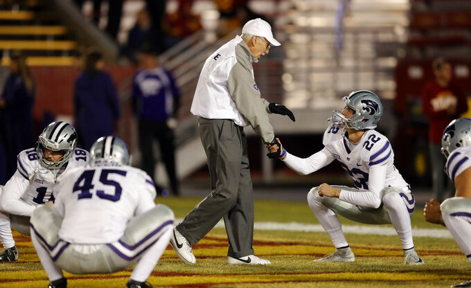 Kansas State head coach Bill Snyder greets place kicker Nick McLellan (22) before an NCAA college football game against Iowa State, Saturday, Nov. 24, 2018, in Ames, Iowa. (AP Photo/Charlie Neibergall)