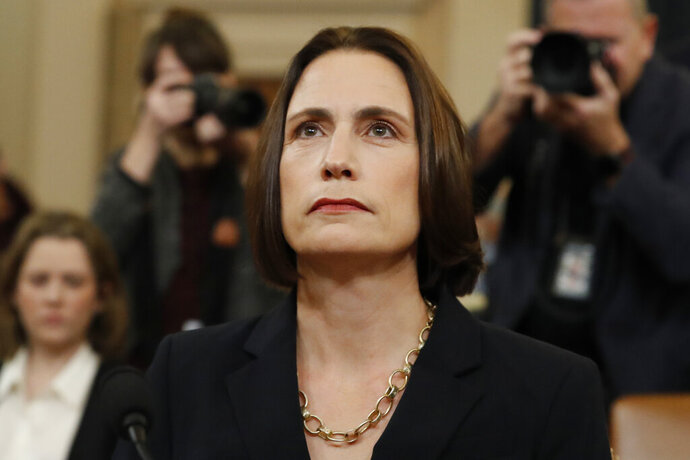 Former White House national security aide Fiona Hill, arrives to testify before the House Intelligence Committee on Capitol Hill in Washington, Thursday, Nov. 21, 2019, during a public impeachment hearing of President Donald Trump's efforts to tie U.S. aid for Ukraine to investigations of his political opponents. (AP Photo/Alex Brandon)