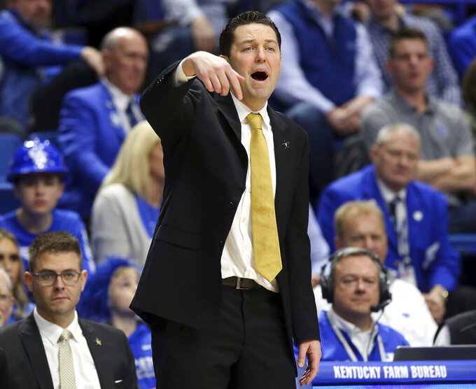 Vanderbilt head coach Bryce Drew directs his team during the first half of an NCAA college basketball game against Kentucky in Lexington, Ky., Saturday, Jan. 12, 2019. (AP Photo/James Crisp)