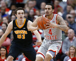 Ohio State guard Duane Washington, right, passes the ball away from Iowa forward Nicholas Baer during the first half of an NCAA college basketball game in Columbus, Ohio, Tuesday, Feb. 26, 2019. (AP Photo/Paul Vernon)