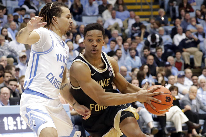 FILE - In this March 3, 2020, file photo, Wake Forest's Jahcobi Neath, right, drives against North Carolina's Cole Anthony (2) during the second half of an NCAA college basketball game in Chapel Hill, N.C. Wisconsin has added Wake Forest transfer Neath to its backcourt. Neath, who is 6-foot-3, averaged 3.8 points, 1.7 assists and 15.8 minutes this past season as a sophomore at Wake Forest. (AP Photo/Chris Seward, File)
