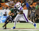 Louisiana Tech defensive end Jaylon Ferguson (45) sacks Hawaii quarterback Chevan Cordeiro (12) in the first half of the Hawaii Bowl NCAA college football game, Saturday, Dec. 22, 2018, in Honolulu. (AP Photo/Eugene Tanner)