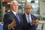 U.S. Commerce Secretary Wilbur Ross, right, looks on as U.S. Vice President Mike Pence speaks to the media at medical-device manufacturer Merit Medical Thursday, Aug. 22, 2019, in South Jordan, Utah. Pence is visiting Utah on a trip to promote the Trump administration's trade deal with Mexico and Canada. (AP Photo/Rick Bowmer)