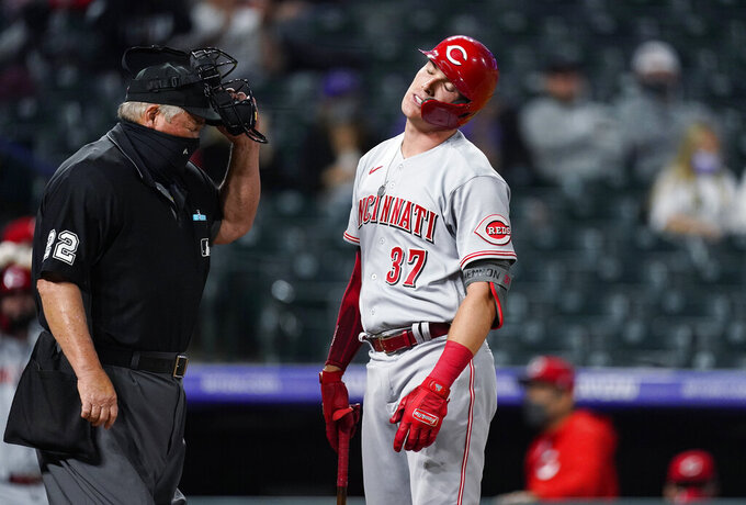 Cincinnati Reds' Tyler Stephenson reacts after he was called out on strikes on a check swing by home plate umpire Joe West while facing Colorado Rockies relief pitcher Mychal Givens during the eighth inning of a baseball game Thursday, May 13, 2021, in Denver. (AP Photo/David Zalubowski)