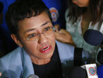 Maria Ressa, the award-winning head of a Philippine online news site Rappler, talks to the media after posting bail at a Regional Trial Court following an overnight arrest by National Bureau of Investigation agents on a libel case Thursday, Feb. 14, 2019 in Manila, Philippines. Ressa was freed on bail Thursday after her arrest in a libel case. (AP Photo/Bullit Marquez)