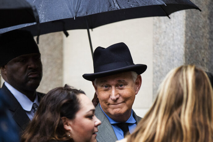 FILE - In this Nov. 12, 2019 file photo, Roger Stone, a longtime Republican provocateur and former confidant of President Donald Trump, waits in line at the federal court in Washington. A Justice Department official tells the AP that the agency is backing away from its sentencing recommendation of between seven to nine years in prison for Trump confidant Roger Stone.  (AP Photo/Manuel Balce Ceneta)