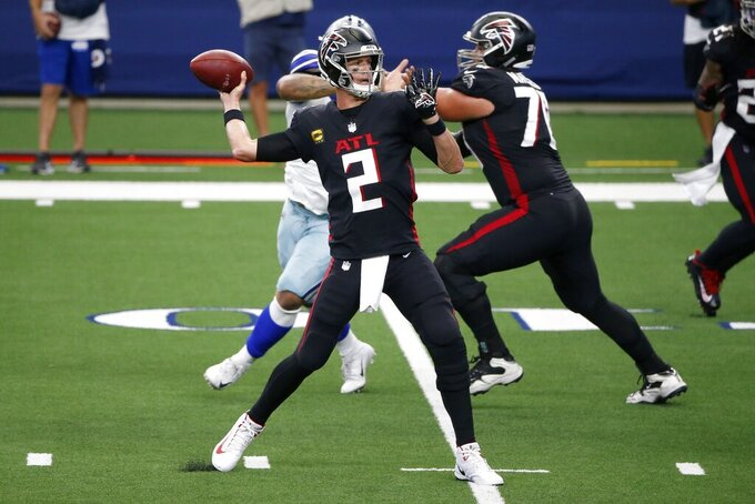 Atlanta Falcons quarterback Matt Ryan throws a pass in the first half of an NFL football game against the Dallas Cowboys in Arlington, Texas, Sunday, Sept. 20, 2020. (AP Photo/Michael Ainsworth)