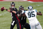 Atlanta Falcons quarterback Matt Ryan (2) works under pressure from Carolina Panthers defensive tackle Derrick Brown (95) during the first half of an NFL football game, Sunday, Oct. 11, 2020, in Atlanta. (AP Photo/John Bazemore)