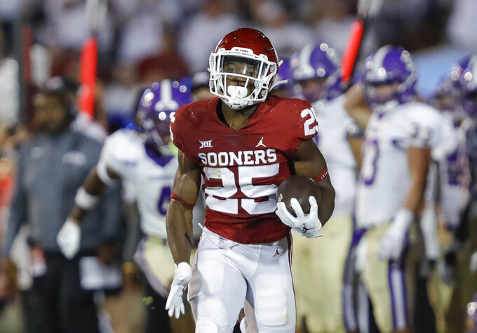 Oklahoma running back Jaden Knowles runs for a first down against Western Carolina during the second half of an NCAA college football game Saturday, Sept. 11, 2021, in Norman, Okla. Oklahoma won 76-0. (AP Photo/Alonzo Adams)
