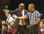 Arkansas head coach Mike Anderson, left, argues a call with a referee during the first half of an NCAA college basketball game against Missouri Tuesday, Feb. 12, 2019, in Columbia, Mo. Missouri won the game 79-78.(AP Photo/L.G. Patterson)
