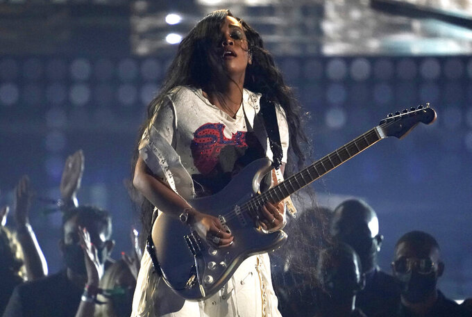 """FILE - H.E.R. performs at the BET Awards on June 27, 2021, in Los Angeles. In addition to making great music, the Grammy and Oscar-winning recording artist wants to be an active citizen that empowers young people with information. Shegets to do both in the new animated Netflix series, """"We the People."""" (AP Photo/Chris Pizzello, File)"""