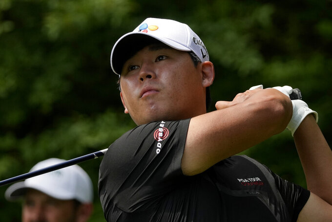 Si Woo Kim, of South Korea, watches his tee shot on the 14th hole during the first round of the Masters golf tournament on Thursday, April 8, 2021, in Augusta, Ga. (AP Photo/Charlie Riedel)