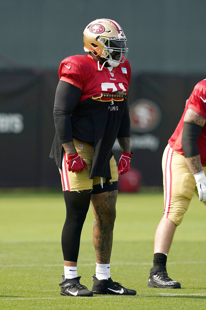 San Francisco 49ers' Trent Williams stands on the field during NFL football practice in Santa Clara, Calif., Tuesday, Aug. 18, 2020. (AP Photo/Jeff Chiu, Pool)