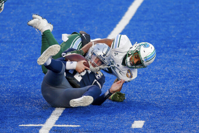 Tulane safety Macon Clark sacks Nevada quarterback Carson Strong (12) during the second half of the Famous Idaho Potato Bowl NCAA college football game, Tuesday, Dec. 22, 2020, in Boise, Idaho. Nevada won 38-27. (AP Photo/Steve Conner)