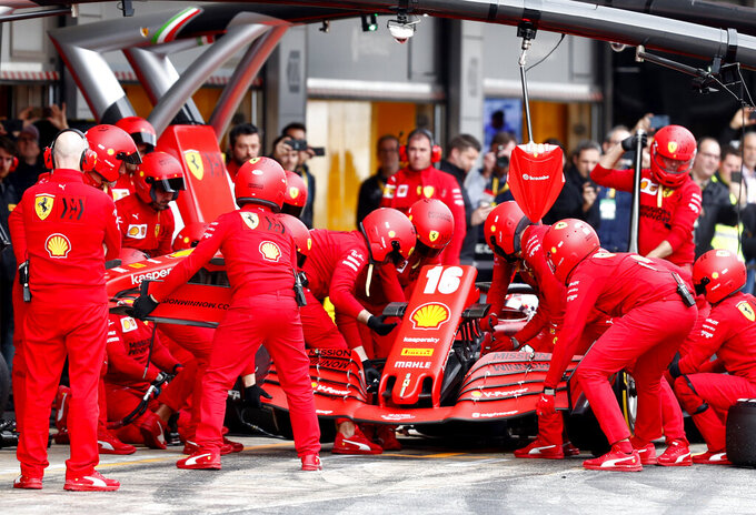 Pit crew work on the car of Ferrari driver Charles Leclerc of Monaco during the Formula One pre-season testing session at the Barcelona Catalunya racetrack in Montmelo, outside Barcelona, Spain, Friday, Feb. 28, 2020. (AP Photo/Joan Monfort)