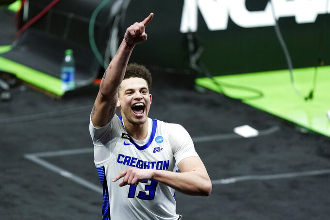 Creighton's Christian Bishop waves to the fans as he leaves the court after a 63-62 win over UC Santa Barbara in a college basketball game during the first round of the NCAA tournament at Lucas Oil Stadium in Indianapolis Saturday, March 20, 2021. (AP Photo/Mark Humphrey)