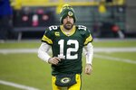 Green Bay Packers' Aaron Rodgers runs off the field after an NFL football game against the Carolina Panthers Saturday, Dec. 19, 2020, in Green Bay, Wis. The Packers won 24-16. (AP Photo/Mike Roemer)