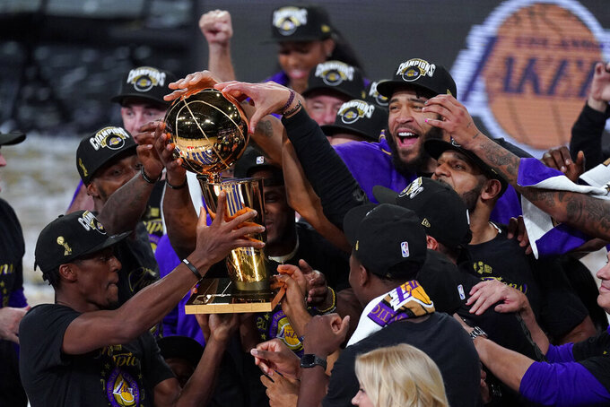 The Los Angeles Lakers players celebrate after the Lakers defeated the Miami Heat 103-88 in Game 6 of basketball's NBA Finals Sunday, Oct. 11, 2020, in Lake Buena Vista, Fla. (AP Photo/Mark J. Terrill)