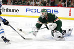 Minnesota Wild goalie Deva Dubnyk makes a save against Winnipeg Jets left wing Nikolay Ehlers (27) in the second period of an NHL hockey game Saturday, Jan. 4, 2020, in St. Paul, Minn. (AP Photo/Andy Clayton-King)