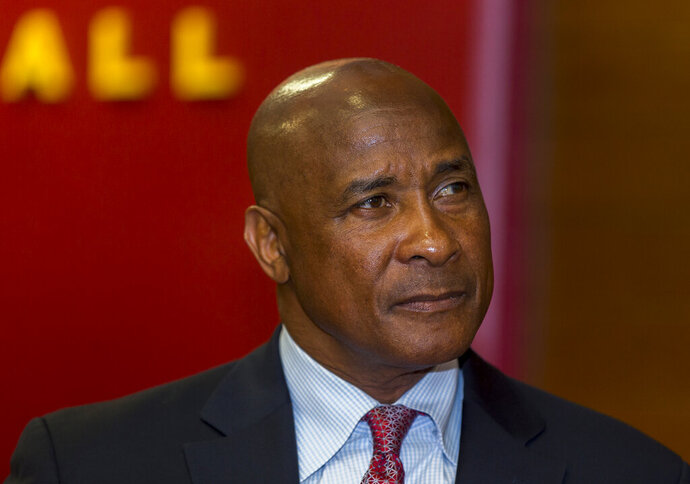 FILE - In this April 14, 2016, file photo, University of Southern California's new athletic director Lynn Swann pauses during his appointment news conference at the USC campus in Los Angeles. Southern California athletic director Swann has resigned. USC President Carol L. Folt announced the decision in a letter Monday, Sept. 9, 2019. (AP Photo/Damian Dovarganes, File)