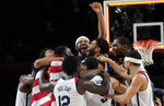 United States' players celebrate after their win in the men's basketball gold medal game against France at the 2020 Summer Olympics, Saturday, Aug. 7, 2021, in Saitama, Japan. (AP Photo/Eric Gay)