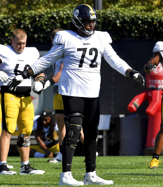 Pittsburgh Steelers offensive tackle Zach Banner stretches during NFL football practice, Wednesday, Oct. 6, 2021,  in Pittsburgh. (Matt Freed/Pittsburgh Post-Gazette via AP)