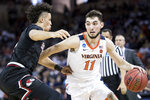 Virginia guard Ty Jerome (11) dribbles the ball against Gardner-Webb guard Jose Perez, left, during a first-round game in the NCAA men's college basketball tournament Friday, March 22, 2019, in Columbia, S.C. (AP Photo/Sean Rayford)