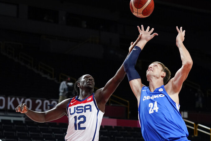 United States's Jrue Holiday (12) fights for a rebound with the Czech Republic's Jan Vesely (24) during a men's basketball preliminary round game at the 2020 Summer Olympics, Saturday, July 31, 2021, in Saitama, Japan. (AP Photo/Charlie Neibergall)