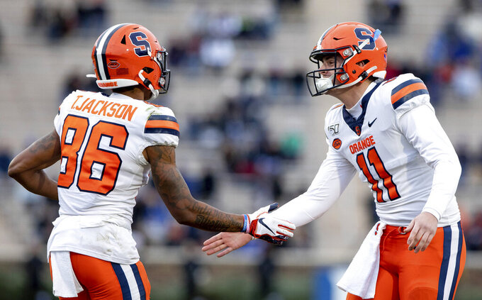 Syracuse's Clayton Welch (11) and Trishton Jackson (86) celebrate after Jackson scored a touchdown during the first half of an NCAA college football game against Duke in Durham, N.C., Saturday, Nov. 16, 2019. (AP Photo/Ben McKeown)