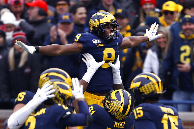 FILE - Michigan wide receiver Donovan Peoples-Jones (9) celebrates his 25-yard touchdown reception against Ohio State during the first half of an NCAA college football game in Ann Arbor, Mich., in this Saturday, Nov. 30, 2019, file photo. Michigan canceled its annual rivalry game at Ohio State on Tuesday, Dec. 8, 2020, because of the COVID-19 outbreak within the Wolverines football program.(AP Photo/Paul Sancya, File)