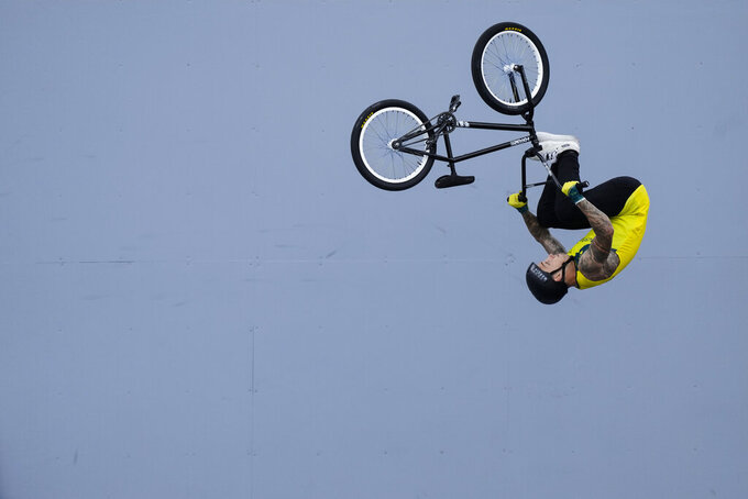 Logan Martin of Australia makes a jump in the men's BMX Freestyle seeding at the 2020 Summer Olympics, Saturday, July 31, 2021, in Tokyo, Japan. (AP Photo/Ben Curtis)