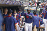 Minnesota Twins's Miguel Sano is greeted in dugout after hitting a home. run in the fourth inning of a baseball game against Detroit Tigers, Wednesday, July 28, 2021, in Minneapolis. (Glen Stubbe/Star Tribune via AP)