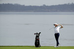 Justin Thomas hits from the fairway on the fourth hole during a practice round for the U.S. Open golf tournament Tuesday, June 11, 2019, in Pebble Beach, Calif. (AP Photo/Marcio Jose Sanchez)