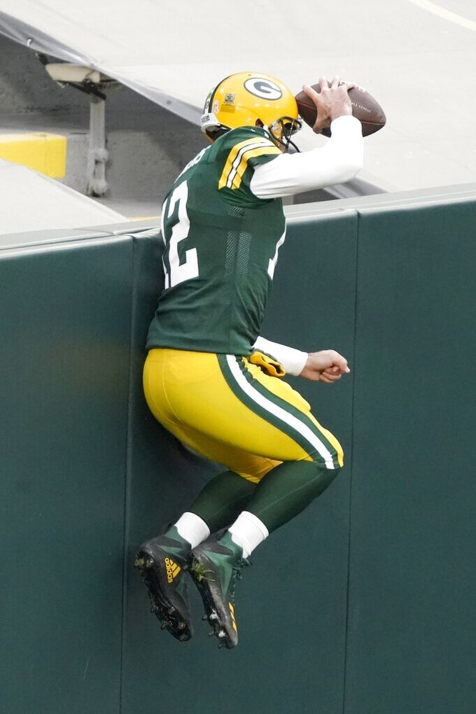 Green Bay Packers' Aaron Rodgers reacts after running for a touchdown during the first half of an NFL football game Sunday, Nov. 15, 2020, in Green Bay, Wis. (AP Photo/Morry Gash)
