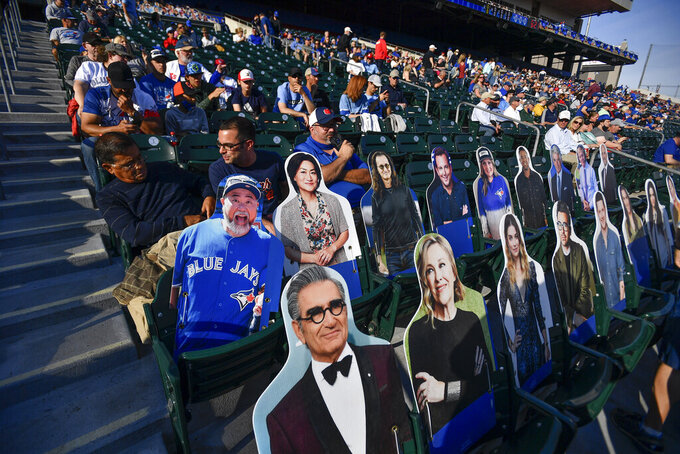 Fans and cardboard cutouts of celebrities fill the stands at Sahlen Field before a baseball game between the Toronto Blue Jays and the Miami Marlins in Buffalo, N.Y., Tuesday, June 1, 2021. (AP Photo/Adrian Kraus)